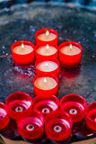 Votive candles forming the Cross. Votive candles form the symbol of the Cross royalty free stock image