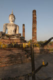 Votive candles and Giant Buddha at Wat Mahathat in Sukhothai, Th Stock Photos