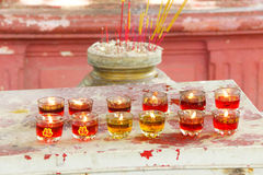 Votive candles and incense Royalty Free Stock Image