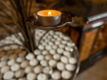 Votive candles inside the church stock photo