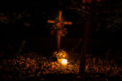 Votive candles lantern burning on the graves in Slovak cemetery at night time. All Saints' Day. Solemnity of All Saints Royalty Free Stock Image