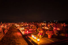 Votive candles lantern burning on the graves in Slovak cemetery at night time. All Saints' Day. Solemnity of All Saints Royalty Free Stock Images