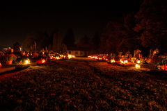 Votive candles lantern burning on the graves in Slovak cemetery at night time. All Saints' Day. Solemnity of All Saints Royalty Free Stock Photos