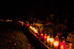 Votive candles lantern burning on the graves in Slovak cemetery at night time. All Saints' Day. Solemnity of All Saints. All Hallows eve. 1st November. Feast Royalty Free Stock Photos