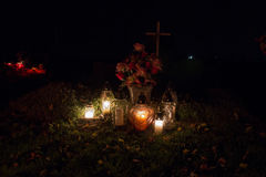 Votive candles lantern burning on the graves in Slovak cemetery at night time. All Saints' Day. Solemnity of All Saints Royalty Free Stock Photography