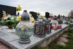 Votive candles lantern on the grave in Slovak cemetery. All Saints' Day. Solemnity of All Saints. All Hallows eve stock photo