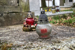 Votive candles lantern on the grave in Slovak cemetery. All Saints' Day. Solemnity of All Saints. All Hallows eve. 1st November. Feast of All Saints. Hallowmas Stock Photo