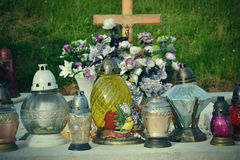Votive candles lantern on the grave in Slovak cemetery. All Saints' Day. Solemnity of All Saints. All Hallows eve Royalty Free Stock Image