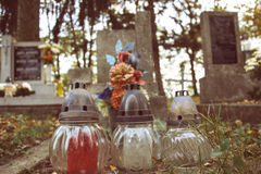Votive candles lantern on the grave in Slovak cemetery. All Saints' Day. Solemnity of All Saints. All Hallows eve Royalty Free Stock Images