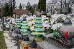 Votive candles lantern on the grave in Slovak cemetery. All Saints' Day. Solemnity of All Saints. All Hallows eve. 1st November. Feast of All Saints. Hallowmas Royalty Free Stock Photos