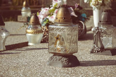 Votive candles lantern on the grave in Slovak cemetery. All Saints' Day. Solemnity of All Saints. All Hallows eve. 1st November. Feast of All Saints. Hallowmas Royalty Free Stock Image