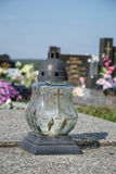 Votive candles lantern on the grave in Slovak cemetery. All Saints' Day. Solemnity of All Saints. All Hallows eve. 1st November. Feast of All Saints. Hallowmas Royalty Free Stock Photo