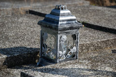 Votive candles lantern on the grave in Slovak cemetery. All Saints' Day. Solemnity of All Saints. All Hallows eve. 1st November. Feast of All Saints. Hallowmas Royalty Free Stock Photography