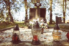 Votive candles lantern on the grave in Slovak cemetery. All Saints' Day. Solemnity of All Saints. All Hallows eve. 1st November. Feast of All Saints. Hallowmas Stock Images
