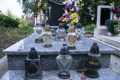 Votive candles lantern on the grave in Slovak cemetery. All Saints' Day. Solemnity of All Saints. All Hallows eve. 1st November. Feast of All Saints. Hallowmas Stock Image