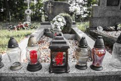 Votive candles lantern on the grave in Slovak cemetery. All Saints' Day. Solemnity of All Saints. All Hallows eve. 1st November. Feast of All Saints. Hallowmas Stock Photography