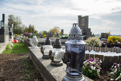 Votive candles lantern on the grave in Slovak cemetery. All Saints' Day. Solemnity of All Saints. All Hallows eve Royalty Free Stock Photo