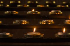 Votive Candles. Lit as prayers for loved ones ine a Christian church royalty free stock images
