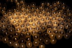 Votive candles. Lit in the church royalty free stock photo