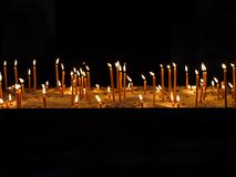 Votive candles. Rows of lit votive candles Stock Image