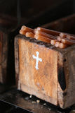 Votive candles in wooden box Royalty Free Stock Photos