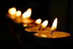 Votive Church Candles. A row of tea light candles in a Catholic Church Stock Photo