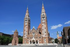The Votive Church and Cathedral of Our Lady of Hungary is a twin-spired roman catholic cathedral in Szeged, Hungary. It lies on Do. M Ter square beside the royalty free stock photography
