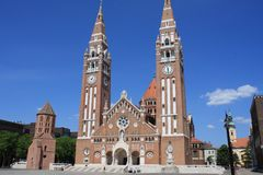 The Votive Church and Cathedral of Our Lady of Hungary is a twin-spired roman catholic cathedral in Szeged, Hungary. It lies on Do. M Ter square beside the royalty free stock photos