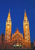 Votive Church at night 08, Szeged, Hungary. The front of the neo-romanesque architectural style cathedral of the Szeged city in southern Hungary, known under the stock image