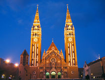 Votive Church at night 09, Szeged, Hungary. The front of the neo-romanesque architectural style cathedral of the Szeged city in southern Hungary, known under the royalty free stock photography