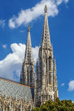 Votive Church, Vienna. The Votive Church is a neo-Gothic church located on the Ringstrasse in Vienna, Austria. Towers stock photography