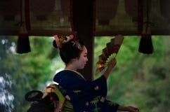 Votive dance by Maiko girl at shrine. Kyoto Japan Stock Photo