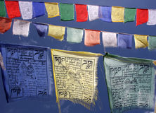 Votive flags in the sky. Buddhist votive flags flying in the sky stock photography
