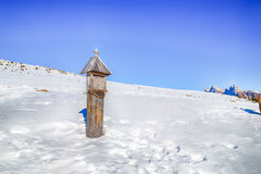 votive shrine in the snow Stock Photography