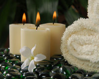 Votive Spa Candles. Three votive spa candles in a tropical, exotic setting royalty free stock photos