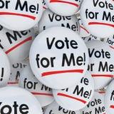 Voto per me fare una campagna di sostegno del candidato di elezione dei perni dei bottoni Immagini Stock