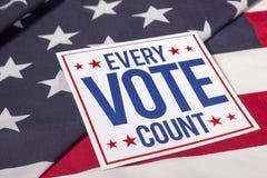 Voto y bandera americana Foto de archivo libre de regalías