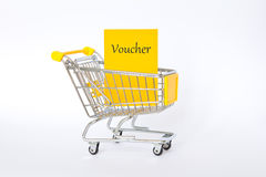 Voucher shopping cart yellow Royalty Free Stock Photography