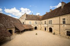 Chateau du Clos de Vougeot courtyard. Cote de Nuits, Burgundy, France. VOUGEOT, FRANCE: Chateau du Clos de Vougeot courtyard. Clos de Vougeot is the largest royalty free stock images