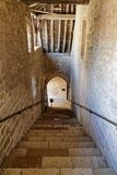 Old stairs in Chateau du Clos de Vougeot. VOUGEOT, FRANCE, May 19, 2018 : Old stair in Chateau du Clos de Vougeot. Clos de Vougeot is the largest single vineyard royalty free stock photo