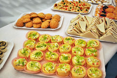 Voulevant. Sandwiches and pastries on a table Stock Photos
