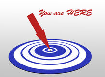 Vous lancez ici la cible sur le marché avec la flèche Photo libre de droits