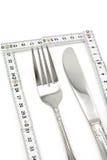 Vouwbaar Meetlint en vork stock afbeelding