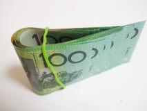 Vouwen groene Australische $100 dollarsnota's Stock Foto's