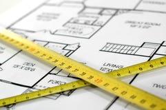 Vouwmeters en huis architecturaal plan royalty-vrije stock foto