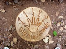 Vowel signs. How to sign the vowels, plaque at rushcliffe country park sensory garden Royalty Free Stock Photos