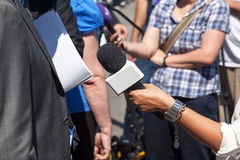 A vox populi interview. Broadcast journalism. Man on the street interview Royalty Free Stock Image