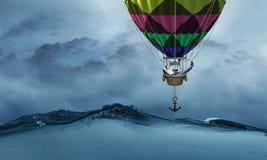 Voyage d'homme d'affaires sur le ballon à air Photographie stock