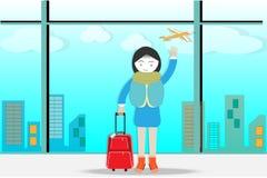 Voyage et bagage se tenant à l'aéroport tout en attendant à l'embarquement Photographie stock libre de droits