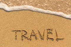 Voyage - inscription sur le sable Image stock